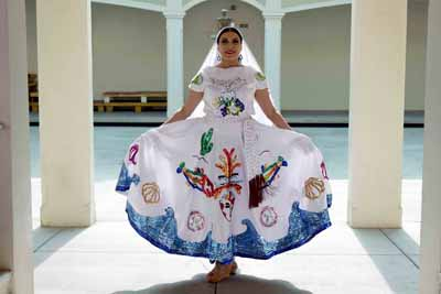 Latina dancer posing in costumes