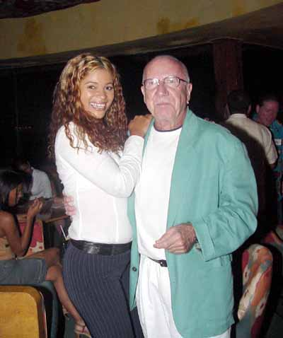 A beautiful young Latin woman with an older foreign gentleman.